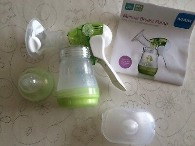Mam manual breast pump and nipple shields.