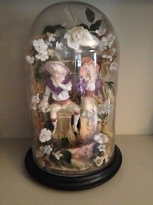 Victorian glass dome with bisque porcelain girl and boy figurines