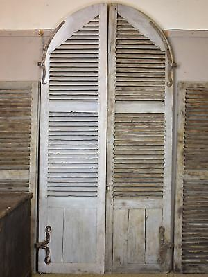 Large curved 18th century shutters from a French chateau