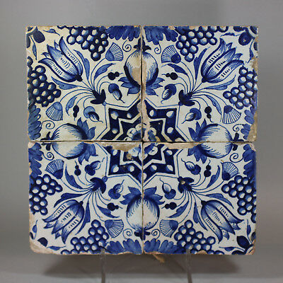 Antique Panel of four Dutch delft blue and white 'tulip' tiles, c. 1610-40