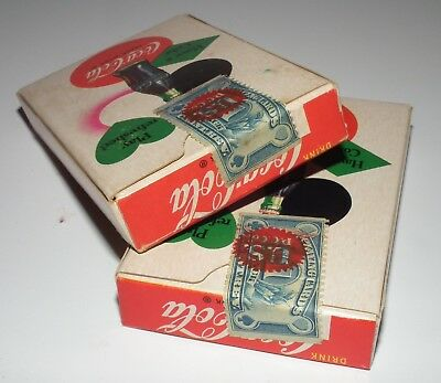 Two decks of 1951 Coca-Cola playing cards still sealed with tax stamps