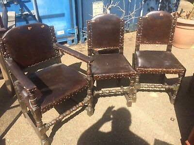 Three Oak and Leather Brass Studded Chairs