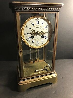 An Antique French Brass And Glass Mantel Clock