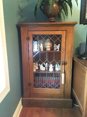 Matching Antique Leaded Glass Bookcases.   Same color just different lighting.
