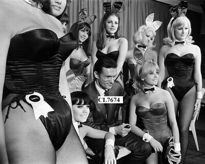 Hugh Hefner Arrives at London Airport and Welcomed by Playboy Club Bunnies Photo