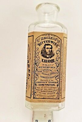Reproduction Glass Medicine Bottle.