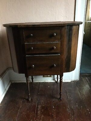 ANTIQUE WOOD SIDE-TABLE with THREE DRAWERS and TWO SIDE BINS