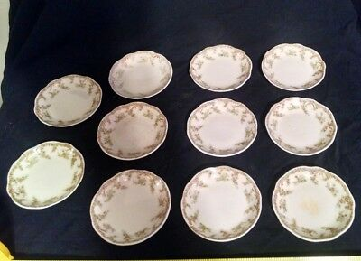 eleven matching China Floral Butter Pat Plates