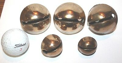 (5)  Antique  bright brass  sleigh bells.  The sizes are #9,#8,#8,#4,#2.   KK