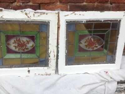 Two antique leaded stained glass  windows hand painted with birds