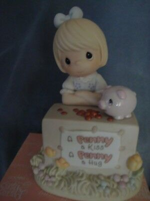 Precious Moments Figurine: A Penny a Kiss A Penny a Hug 101234 New in Box