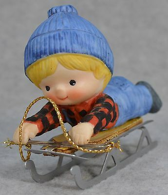 Enesco Country Cousins Blonde Boy in Blue Jeans & Beanie on Snow Sled Figurine