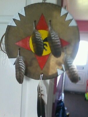 native american style  rawhide war shield  with hawk feather drops