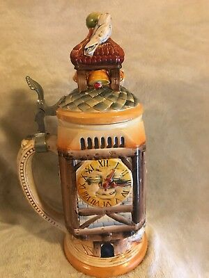 Ornamental Beer stein with birds on top of lid and clocks on the side Germany