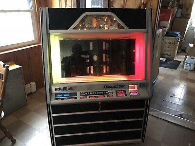 ROWE CD-100 JUKEBOX.  HOLDS 100 CD's. CLEAN, GREAT SOUND, BEAUTIFUL CABINET,
