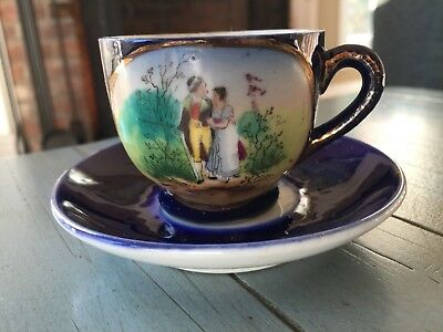Demitasse Teacup Cup and Saucer Vintage Navy Blue With A Courting Couple