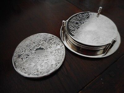 Vintage silver plate set  of 4 matching coasters on stand (plus one close match)