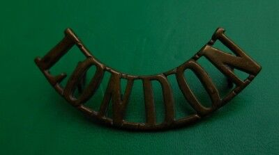 City of London Regiment Shoulder Title all brass and in good condition.