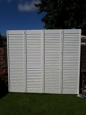 1 pair of brilliant white plantation shutters/louvre doors. Good quality & heavy