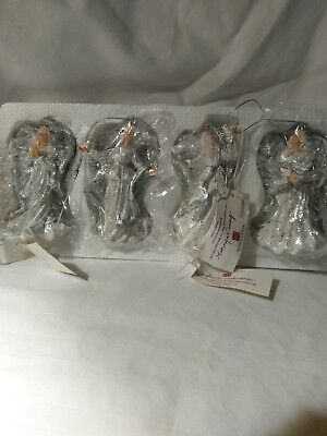 NIB Home Interiors Set of 4 Angel Ornaments Approach 3 1/2 inches tall