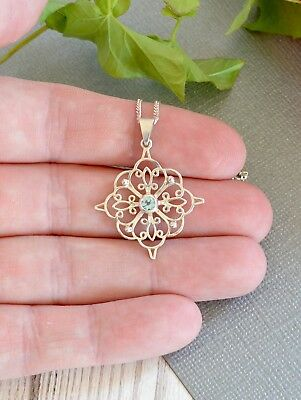 Vintage style sterling silver openwork pendant with blue stone & chain necklace