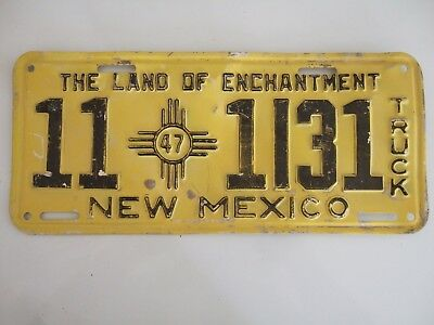 VINTAGE 1947 NEW MEXICO TRUCK LICENSE PLATE  11 zia symbol 1131  BLACK ON YELLOW