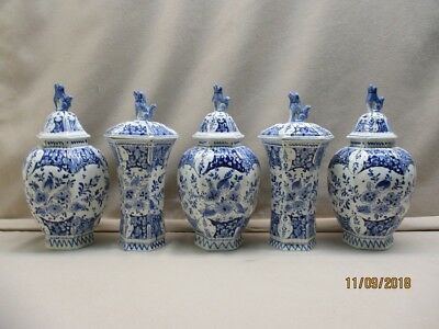 Delft blue 5 pieces antique cabinet set marked Porceleyne Fles, yearsign 1881.