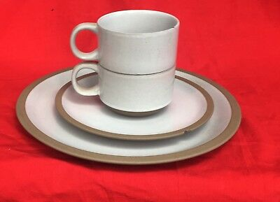 Stoneware Midwinter Natural Plate and Mug Collection with tan rim, two chips
