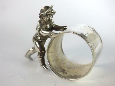 Antique American Silver Plate Plated Napkin Ring Boy Pushing Wheel