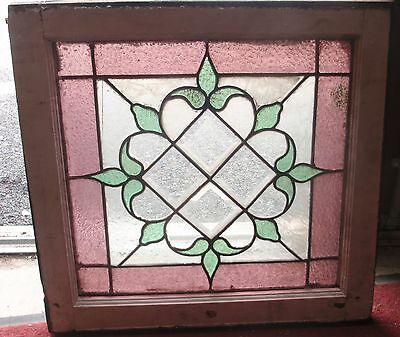 1 of a matched pair of beveled center stained glass windows