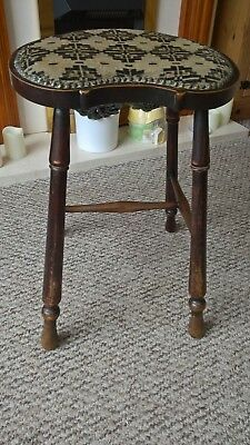 Antique  teak wooden perching stool with studded material  seat