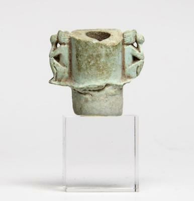 Provenanced Egyptian faience spout with baboons: 7th-1st century BC.