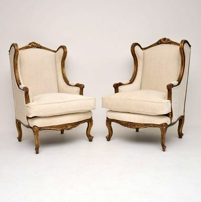 Pair of Antique French Gilt Wood Wing Back Armchairs