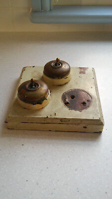 VINTAGE ELECTRIC LIGHT SWITCHES. BRASS & BLACK CERAMIC. On wooden mount.