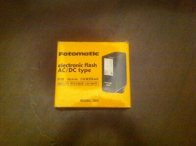 Fotomatic electronic flash AC/DC type // 35 mm CAMERAS // 110-220V