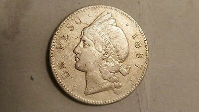 1897 Dominican Republic Silver Coin  One or Un Peso Circulated Condition Coin.