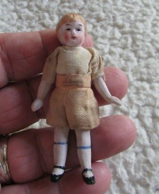 Nice small - approx 3 inch - girl Bisque doll with period outfit - jointed