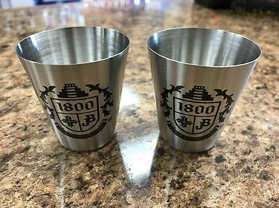 pair of Cuervo 1800 Tequila Stainless Still shot glasses
