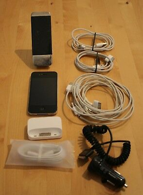 old iPhone w/ stand & TONS of chargers...car charger + a bunch of wall chargers