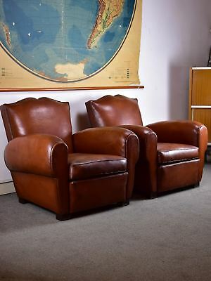 Pair of mustache back French leather club chairs