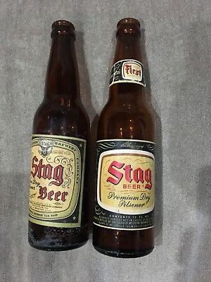 2 Stag beer bottles With paper labels