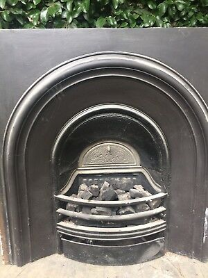 Cast Iron Fire Place Insert Which Has Been Converted to Gas