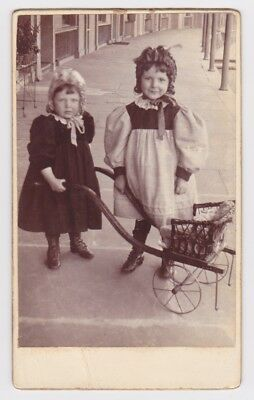 Victorian cdv photo two girls doll in pram  unstated photographer