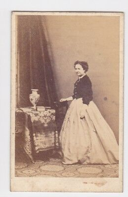 Victorian cdv photo young lady standing long skirt unstated  photographer