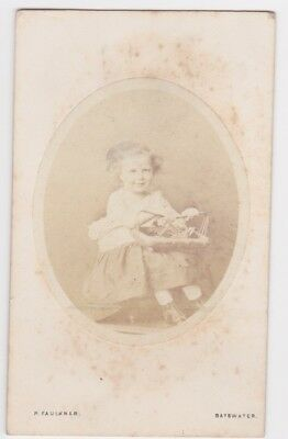 Victorian cdv photo child holding basket Bayswater London  photographer