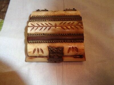 Bone trinket box with carving and brass trim