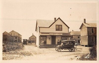 c.1910 RPPC Early Car at HE Lewis Store Quonochontaug RI