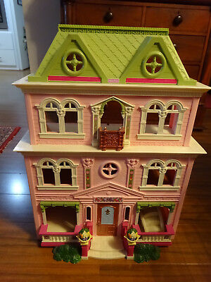 Fisher Price Loving family Doll House with some accessories