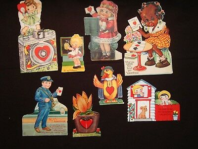 Eight antique valentines, used, with moving parts