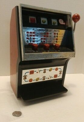 Vintage Toy Slot Machine with two tokens actual working collectible